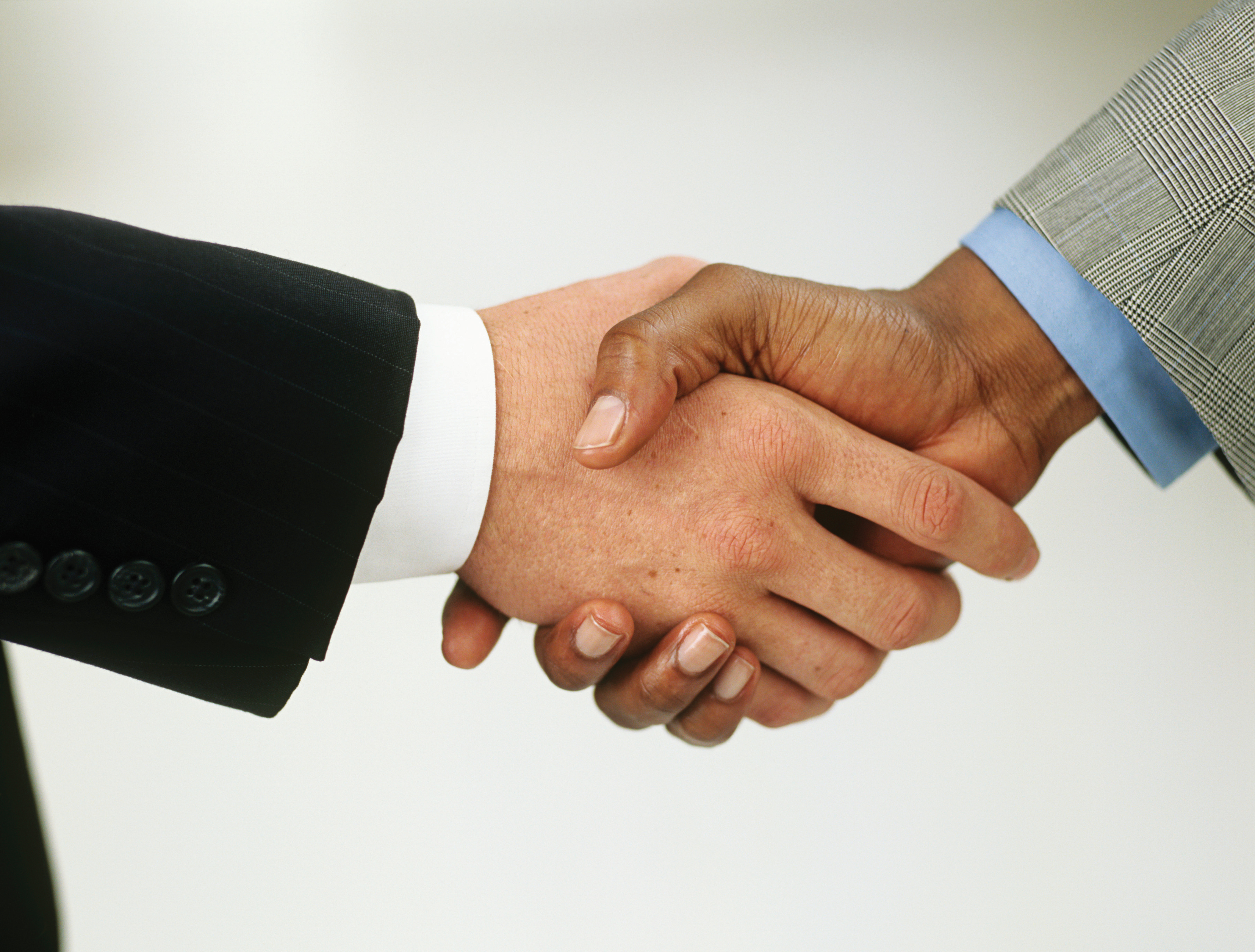 Black And White People Shaking Hands